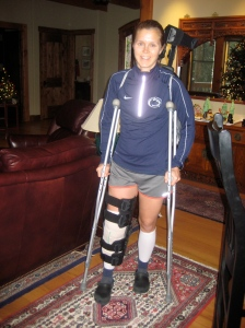 Jen in knee brace with crutches